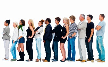 Happy group of people standing in a line.With copyspace